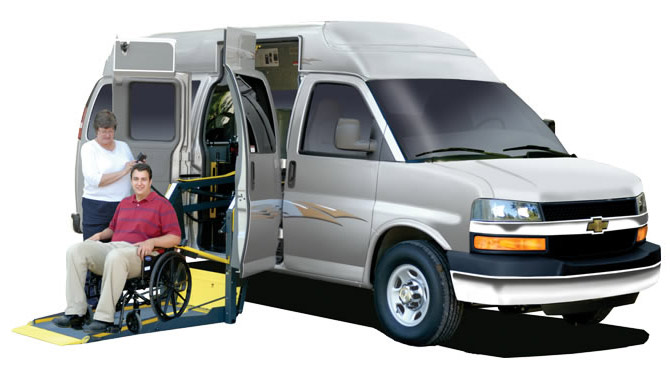 Adaptavan with wheelchair lift depoloyed.  The wheelchair van is red.